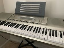 casio keyboard wk200 76 keys with stand used few times by a 6 year old.