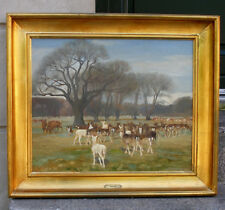 Soren Lund ( Danish.1852) Hinds and stags of red deer grazing in Dyrehaven. 1910