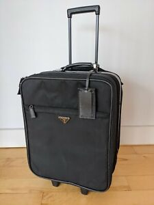 PRADA carry-on, black nylon with leather parts and trims.