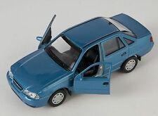 BLITZ VERSAND Chevrolet Nexia II blau / blue Welly Modell Auto 1:34 NEU & OVP