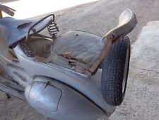 Vespa rear seat of the 50s