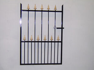4 ft tall wrought iron  garden / side gate very strong hangs on the left !!