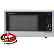 Carousel 1.1 Cu. Ft. 1000W Countertop Microwave Oven with Orville Redenbacher.