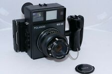 Polaroid 600SE Instant film camera with manual shutter and lens aperture. .