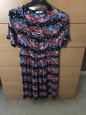 T U BLACK WITH MULTI COLOURED FLORAL PATTERN DRESS SIZE 12 WORN ONCE EX.CON