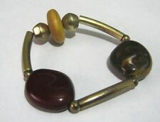 Lovely elasticated beaded bracelet a wooden bead red gold tone plastic