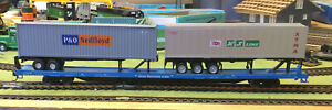 HO Scale Athearn Assembled 85' Flat Car with 2-40' containers on trailers.