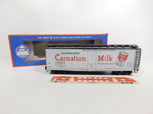 CO324-1# AHM (Pola Maxi) Spur 0/DC 7308 B US-Reefer/Kühlwagen Carnation s.g.+OVP