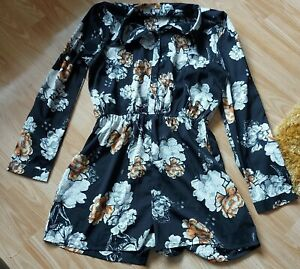 Black Floral,play Suit..(shorts)size 14