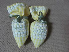 A pair of yellow cotton gingham shoe scenters
