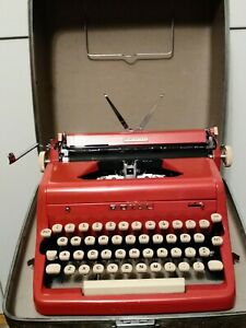 Red Royal Quiet De Luxe portable typewriter with case
