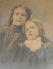 PORTRAIT YOUNG SISTERS, TONED SILVER PRINT, TINTED, FRAMED WITH OVAL MAT. 1900.