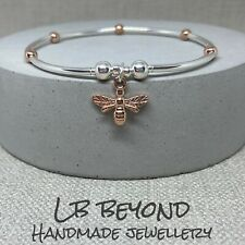 BEE CHARM STERLING SILVER AND ROSE GOLD NOODLE BEAD STRETCH STACKING BRACELET