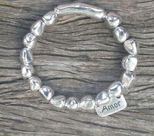 """Pulsera elastica, 50 corazones de zamak """"AMOR"""",hecha de mano,compra uno para ti!"""