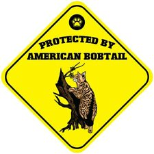 Yellow Aluminum Crossing Sign Protected by American Bobtail Cat Cross Xing