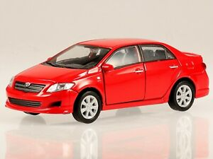 Toyota Corolla E12 9. Generation red diecast model car 43608 Welly 1:36