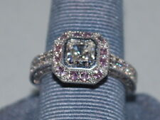 Cz's all set in a very beautiful design 10k white Gold ring with Cz's and pink
