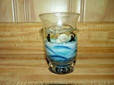 Small candle made from sand with seashells, marked Destin FL, shells starfish