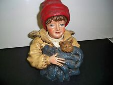 CHILD with RED HAT STATUE with blanketed cat or dog