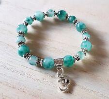 Jade gemstone bracelet with charm om ohm aum symbol yoga positive energy stretch