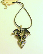 Silver tone dragon wing, bat wing goth cross necklace with clear rhinestone.