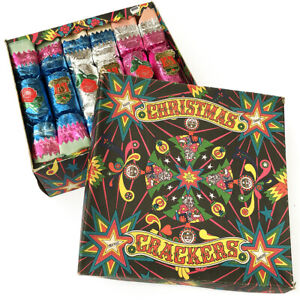 A FINE VINTAGE BOX OF PANTOMIME SERIES CHRISTMAS CRACKERS DECORATIONS