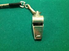 Windsor Clarion referee's whistle. Brass with nickel plating. Nylon lanyard