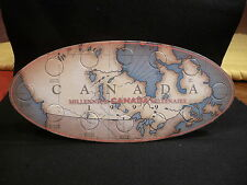 CANADA :1999   MILLENNIUM  25 CENT SOUVENIR OVAL MAP  HOLDER  (#8)
