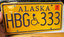 Alaska Handicap Metal License Plate HBG 333, gold style, expired in 2009 tagged