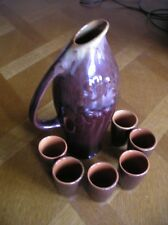 Clay pitcher with 6 shots