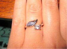 color plata retorcido hoja w/ cristal brillante anillo