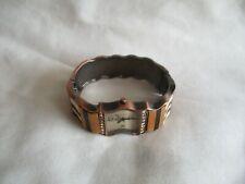 Denacci Analog Wristwatch with a Cuff Band and Quartz Movement