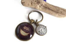 """Alice in Wonderland themed """" cheshire cat """" 25mm Glass Dome keyring gift UK"""