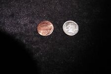 One trick coin, penny side is tails dime side is heads and made from coins Magic