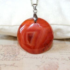 Long silver necklace with burnt orange rust stripe agate pendant