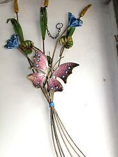 Branch with butterfly wrought iron with butterfly and flowers from the slope at
