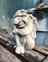 Small gargoyle garden ornament hand over eyes in despair winged gnome gremiln