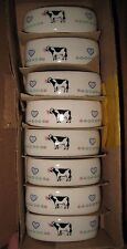 VTG  8pc. CERAMIC NAPKIN RINGS  WITH HOLSTEIN COWS NOS