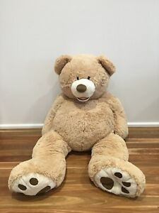 Giant teddy bear, 34 inches tall and 27 inches wide, light brow colour.