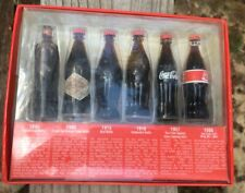 Evolution Of The Coca-Cola Contour Bottle, 6 Mini Bottles of Coke - Display Only
