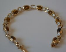 Beautiful Sterling Silver gold plated bracetel with tiger's eye stones.