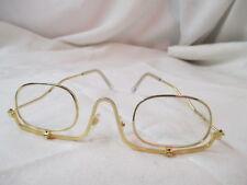 Vintage gold tone Eyeglasses with fold down Lenses