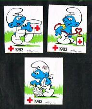 Belgique - Croix-Rouge - Les Schtroumpfs - 3 Autocollants 1983.