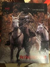 4 Different New Winchester Firearms Catalogs.