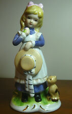 """7"""" Ceramic Figurine of a Shy Girl with Her Cat, Green, Yellow & Lavender Colors"""
