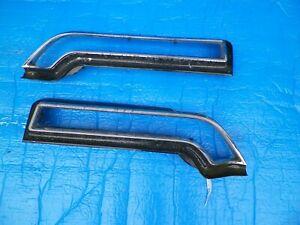 1969 Pontiac Bonneville tail light bezels trim pair cores