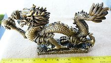 Gold resin Chinese dragon holding crystal ball 9 inches long 4 3/4 inches tall