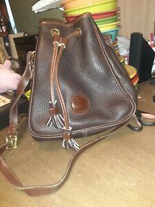 Vintage Dooney & Bourke All Weather Pebbled Leather Drawstring Bucket Bag read