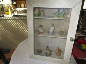 Antique wood cupboard with glass door.