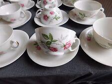 Suite de huit tasses sous tasses à café véritable porcelaine SEP décor à la rose